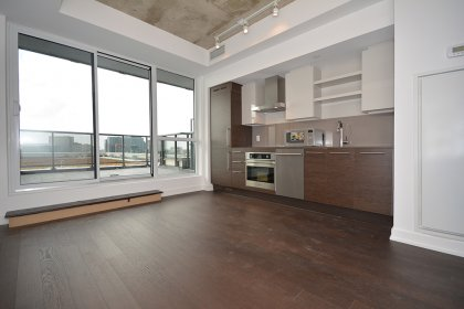 Bright Floor-To-Ceiling Windows With Hardwood Flooring Throughout & A Huge Private Entertaining Terrace Facing Unobstructed Views.