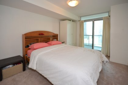 A Spacious Sized Master Bedroom With A Large Closet & Walk-Out To The Balcony.