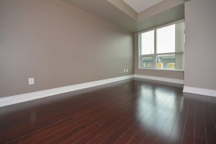 Spacious Sized Master Bedroom With Mirrored Closets & Laminate Flooring Throughout.