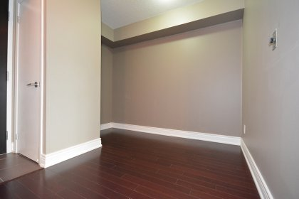 Den Area With Laminate Flooring Throughout.