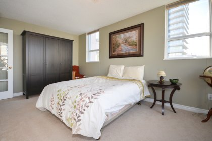 The Large 2nd Bedroom Features Lots Of Natural Light With French Doors & A Walk-Out To The Balcony.