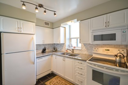 New Remodelled Kitchen With Designer Kitchen Cabinetry, Extra Thick Granite Counter Tops, An Undermount Sink, Marble Backsplash Including Additional P