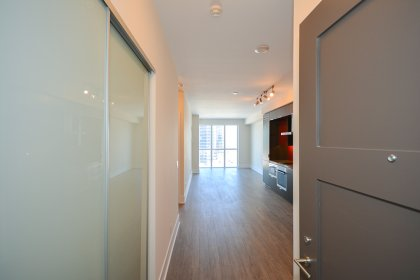 Suite Foyer With Frosted Mirrored Closets.