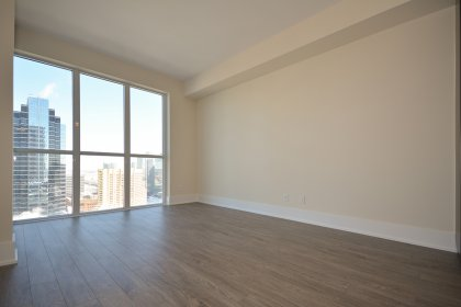Open Concept Living / Dining Areas With Bright Floor-To-Ceiling Windows With Plank Laminate Flooring Throughout & Balcony C.N. Tower and Lake Views.