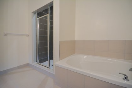 Master Ensuite Has A 4-Piece, Separate Glass Shower & A Relaxing Deep Soaker Tub.