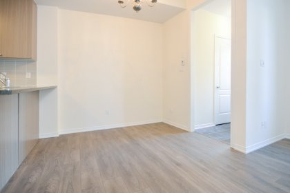 Bright Open Concept Living & Dining Areas With Laminate Flooring Throughout And A Main Floor Powder Room.