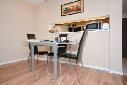 Open Concept Living & Dining Areas With Laminate Flooring Throughout.