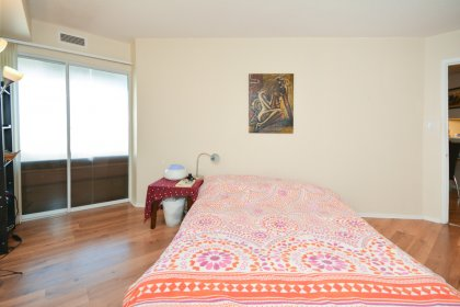 A Spacious Sized Master Bedroom With A Walk-In Closet Including Solarium Room Access.