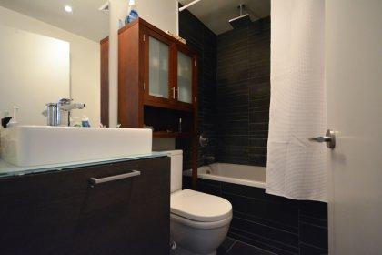 Main Bath With A 4-Piece Ensuite & Spa Like Rainfall Shower.