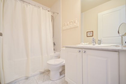 Main Bath With A 4-Piece & A Granite Vanity Counter Top.