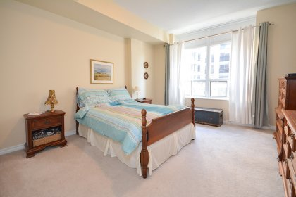 Spacious Sized Master Bedroom With A Large Closet & Bright Large Windows.