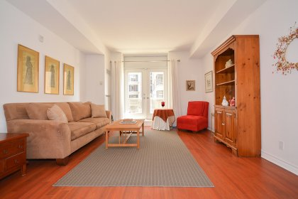 High 9Ft. Ceiling With Bright Large Patio Doors, Laminate Flooring Throughout & A Private Balcony.