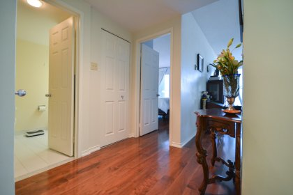 Suite Foyer With A Closet & Gleaming Hardwood Flooring Throughout.