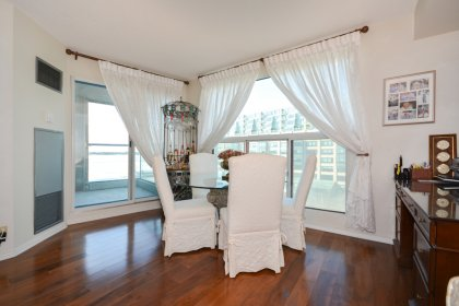 Bright Floor-To-Ceiling Windows With Gleaming Hardwood Flooring Throughout Facing Spectacular C.N. Tower & Lake Views.