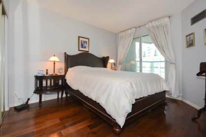 Spacious Sized Master Bedroom With A Mirrored Closet & A Walk-Out Balcony.