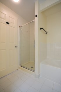 Main Bath With A 4-Piece & A Separate Stand-Up Shower.
