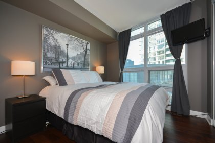 A Spacious Sized Master Bedroom With A 4-Piece Semi-Ensuite, Mirrored Closets & Hardwood Flooring.
