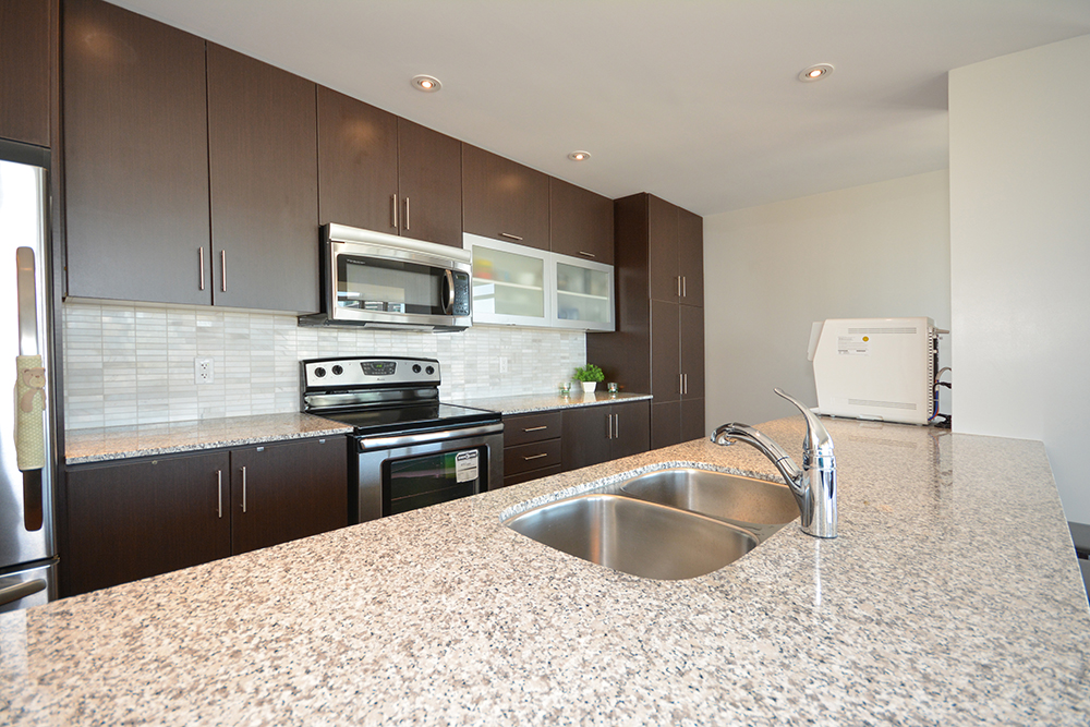 ... Gorgeous Designer Kitchen Cabinetry With Stainless Steel Appliances  Including Wine Fridge, Granite Counter Tops ...