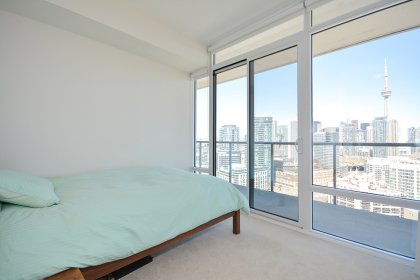 2nd Bedroom With A 3-Piece Ensuite, Large Mirrored Closet & A Walk-Out Balcony Facing C.N Tower & Lake Views.