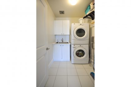A Separate Laundry Room Includes A Stainless Steel Sink For Delicates.