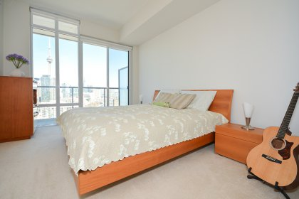 A Spacious Sized Master Bedroom With A 5-Piece Ensuite, Walk-In Closet & Walk-Out Balcony Facing C.N Tower & Lake Views.