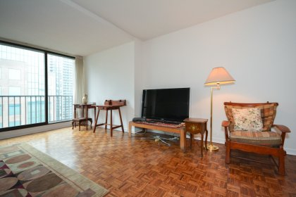 Bright Floor-To-Ceiling Windows With Parquet Flooring Throughout.