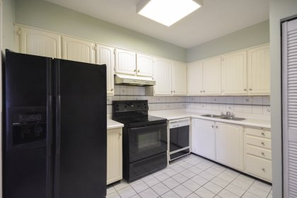 Kitchen Area With Ample Pantry Space And A Pass Throughout Into The Dining Area.