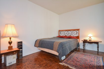 A Spacious Sized Master Bedroom With A Walk-Out Balcony.