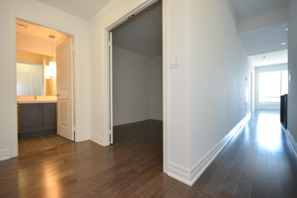 Suite Foyer With Gleaming Hardwood Flooring Throughout.