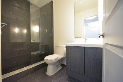 Main Bath With A 3-Piece & Frameless Glass Stand-Up Shower.