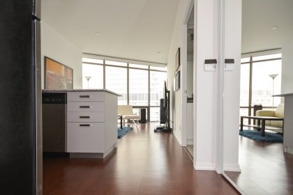 Suite Foyer With Hardwood Flooring & Mirrored Closets.