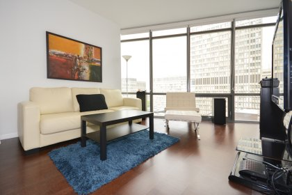 Bright 9 Foot Floor-To-Ceiling Windows With Hardwood Flooring Throughout The Living Areas.