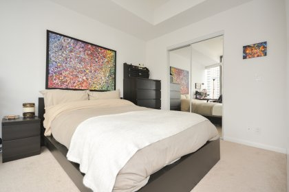Spacious Sized Master Bedroom With A Private Desk Area & Mirrored Closets.