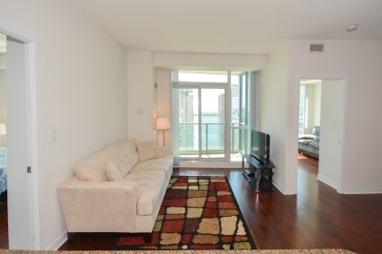 Bright 9 Foot Floor-To-Ceiling Windows With Gleaming Hardwood Flooring Throughout Facing South Lake Views.