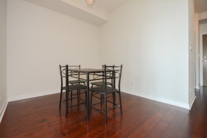 Dining Area With Gleaming Hardwood Flooring Throughout Facing South Lake Views.