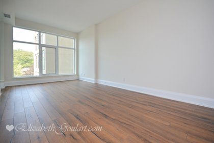 Living / Dining Areas With Bright Floor-To-Ceiling Windows With Plank Laminate Flooring Throughout.