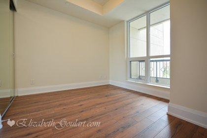Spacious Sized Master Bedroom With Mirrored Closets & Plank Laminate Flooring Throughout.