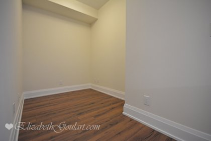 Den Area With Plank Laminate Flooring Throughout.