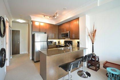 Designer Kitchen Cabinetry With Stainless Steel Appliances, Granite Counter Tops, An Undermount Sink, Undermount Lighting & A Breakfast Bar.