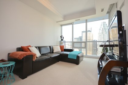 Living & Dining Areas With Bright 9 Ft. Floor-To-Ceiling Windows Facing Unobstructed North City Views.