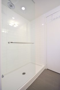 Master Bedroom Ensuite With A Frameless Glass Stand-Up Shower.