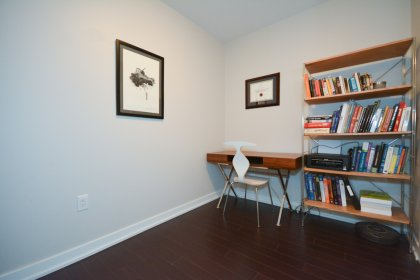 Den / Home Office Area With Laminate Flooring Throughout.