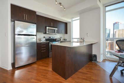 Designer Kitchen Cabinetry With Stainless Steel Appliances, Granite Counter Tops, An Undermount Sink & A Breakfast Bar.
