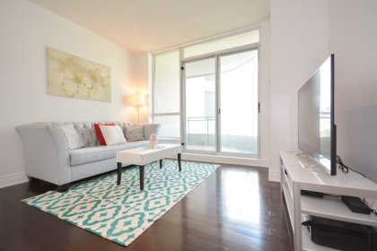 Living / Dining Areas WithBright 9Ft. Floor-To-Ceiling Windows With Gleaming Hardwood Flooring Throughout.