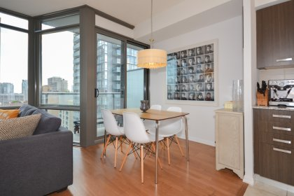 Living / Dining Areas With Bright 9Ft. Floor-To-Ceiling Wrap Around Windows With Hardwood Flooring Throughout.