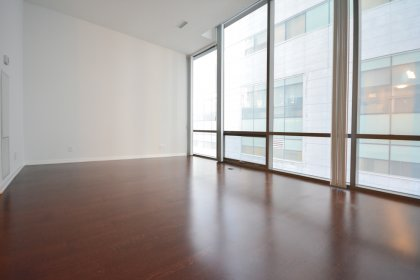 Living / Dining Areas With Bright 10Ft. Floor-To-Ceiling Windows With Hardwood Flooring Throughout.