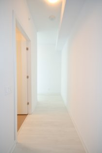 Suite Foyer With Laminate Flooring.