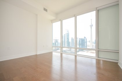 2nd Bedroom Facing Unobstructed C.N. Tower & City Views With Hardwood Flooring.