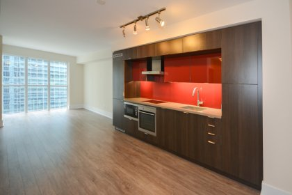 Designer Kitchen Cabinetry With Stainless Steel Appliances, Stone Counter Tops, Undermount Sink & Lighting.