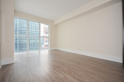Open Concept Living / Dining Areas With Bright Floor-To-Ceiling Windows With Plank Laminate Flooring Throughout & Balcony C.N. Tower Views.